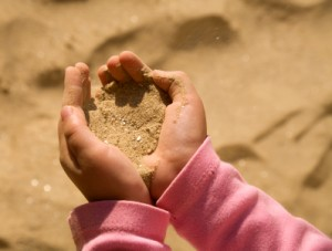 Young child playing with sand